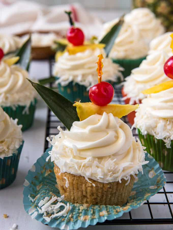 Pina Colada Cupcake with the wrapper peeled back
