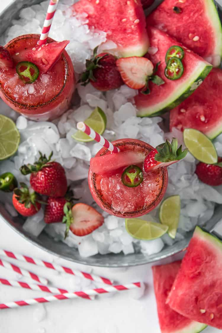 a tray of ice with watermelon margaritas