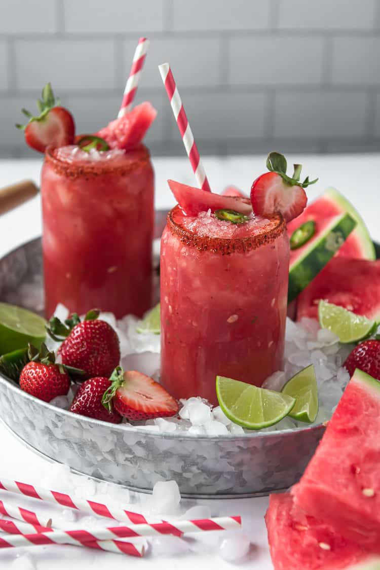 a tray of ice with strawberry watermelon margaritas