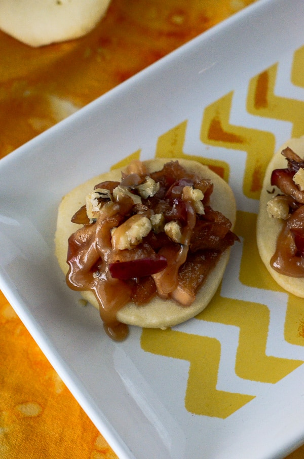 "Caramel Apple Shortbread Bruschetta | Bruschetta for dessert! A soft, melt-in-your-mouth shortbread ""crostini"", smeared with caramel cream cheese and topped with a nutty caramel apple crown."