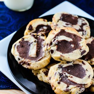 Chocolate Chip Cookie Bronados | A sturdy, cut-out style chocolate chip cookie, filled with brownie batter, rolled, sliced, and baked to brookie-like perfection.