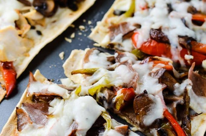 Cheesesteak Flatbread Pizza | These individually sized Cheesesteak Flatbread Pizzas are perfect for lunch or a quick easy dinner, and are a great new take on one of America's favorite sandwiches. Make it with classic beef or switch it up with chicken!
