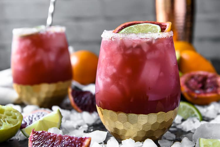 Two Sparkling Blood Orange Margaritas in wine glasses