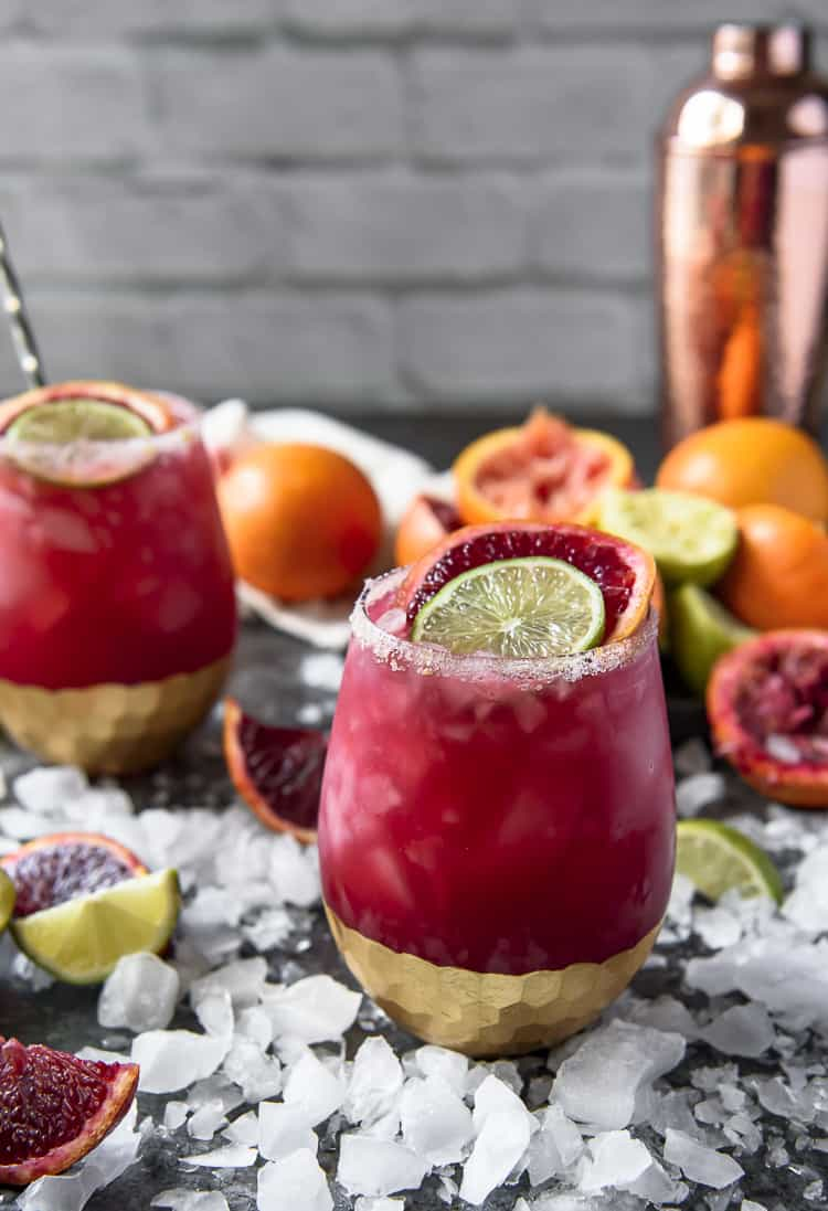 Sparkling Blood Orange Margaritas on a table with ice