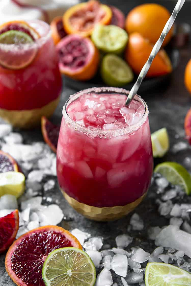 Stirring a Sparkling Blood Orange Margarita