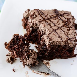 Death By Mocha Poke Cake | A devilish little chocolate cake, infused and topped with Irish cream, vanilla bean, and the World's Strongest Coffee!