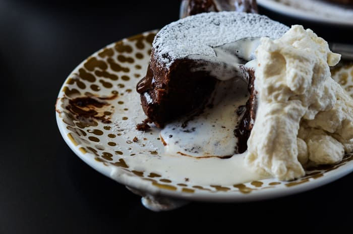Molten Bailey's Lava Cake | A creamy twist on a chocoholic's favorite, this Molten Bailey's Lava Cake is infused and topped with Irish Creme.