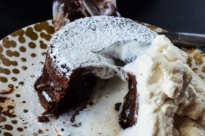 Molten Bailey's Lava Cake | A creamy twist on a chocoholic's favorite, this Bailey's Molten Lava Cake is infused and topped with Irish Creme.