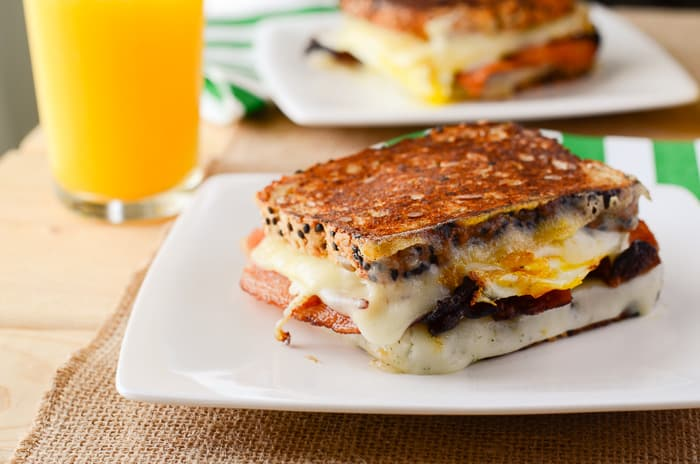 Havarti Breakfast Grilled Cheese Sandwich | A totally perfect, simple breakfast grilled cheese sandwich, made with crispy bacon, fried eggs, and two kinds of Havarti cheese!