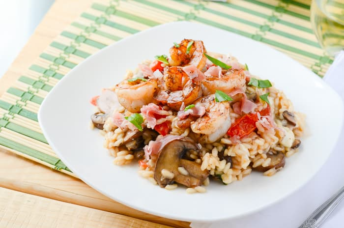 Mushroom Caprese Risotto with Balsamic Shrimp | A traditional side dish is the star of the dinner table in this simple meal, bringing together the classic flavors of caprese, prosciutto, and shrimp in a creamy, white wine risotto.
