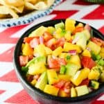 Tropical Avocado Salsa | A slightly spicy, tangy, and sweet salsa, playfully studded with chunks of colorful avocado, pineapple, and mango.