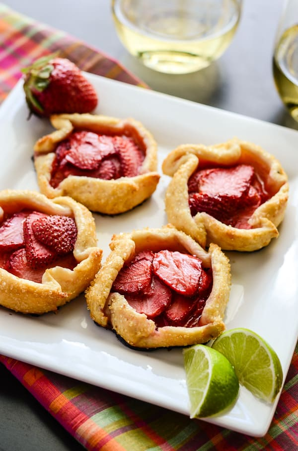 Mini Strawberry Limeade Galettes | These fun little one person, no-fuss tarts are filled with fresh vanilla lime-spiked strawberries, and are a great dessert even for outdoor meals.