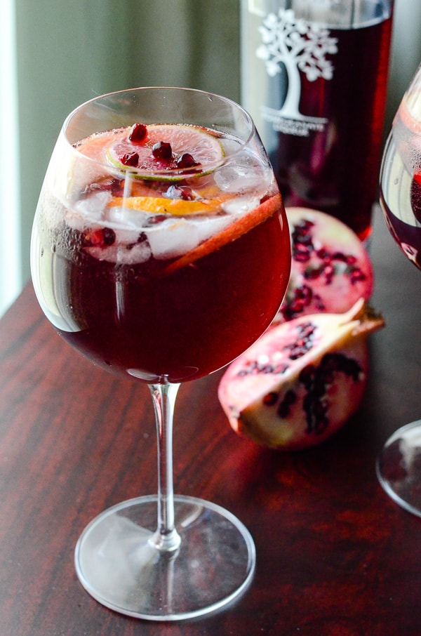 Pomegranate Summer Sangria | Celebrate the warmth of the season with this deep yet refreshing summer sangria, bursting with citrus, dark rum, full red wine, & PAMA Pomegranate Liqueur!