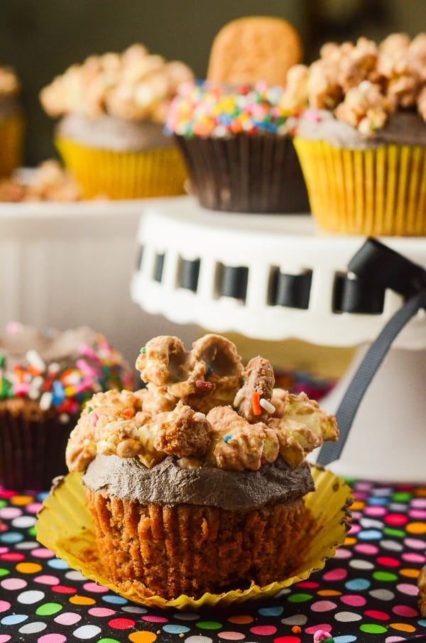 Cookie Butter Popcorn Cupcakes | The simplicity of cupcakes + the intrigue of cookie butter + the whimsy of popcorn = one unique and tasty dessert that's perfect for any celebration!