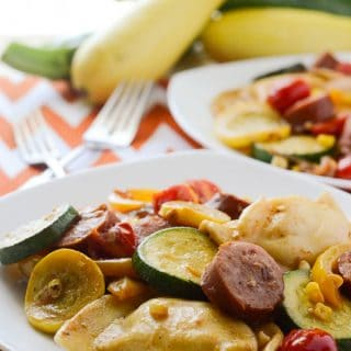 Kielbasa and Pieogies with Summer Vegetables | A summery spin on a Polish classic that's light enough to eat no matter how hot it is! Fresh summer vegetables are sautéed with kielbasa and pierogies, then tossed in a tangy Dijon vinaigrette.