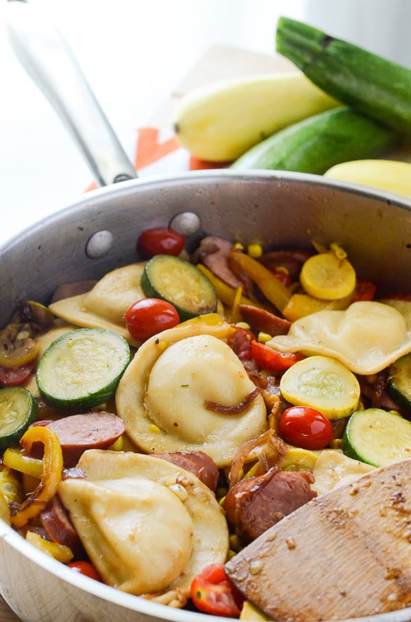 Kielbasa and Pieogies with Summer Vegetables   A summery spin on a Polish classic that's light enough to eat no matter how hot it is! Fresh summer vegetables are sautéed with kielbasa and pierogies, then tossed in a tangy Dijon vinaigrette.
