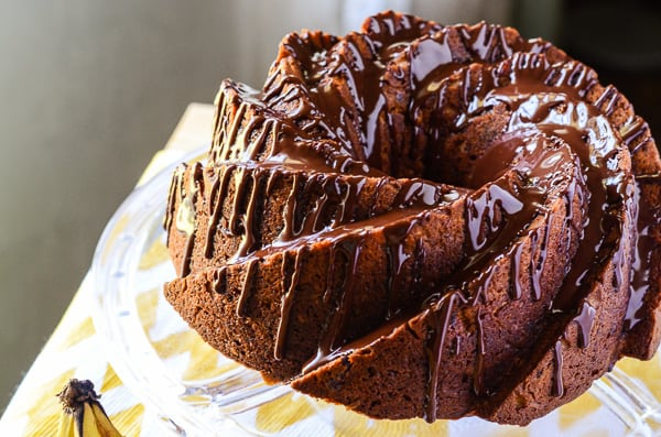 Chunky Monkey Bundt Cake | A favorite ice cream flavor, turned into an incredible bundt cake! This banana chocolate chunk walnut cake is perfect drizzled with ganache & served with a big cup of coffee!