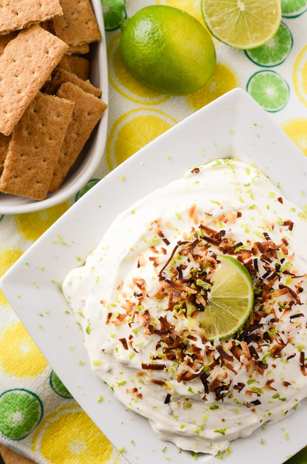 Coconut Key Lime Cheesecake Dip | A fluffy, refreshing, and versatile desert hybrid - key lime cheesecake dip combined with freshly toasted coconut is perfect for graham cracker dunkin'!