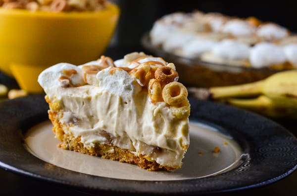 Peanut Butter Banana Cream Pie | Two flavor favorites, blended into one delightful pie filling, topped with fresh whipped cream & bananas, and nestled in a brown sugar & Cheerios crust!