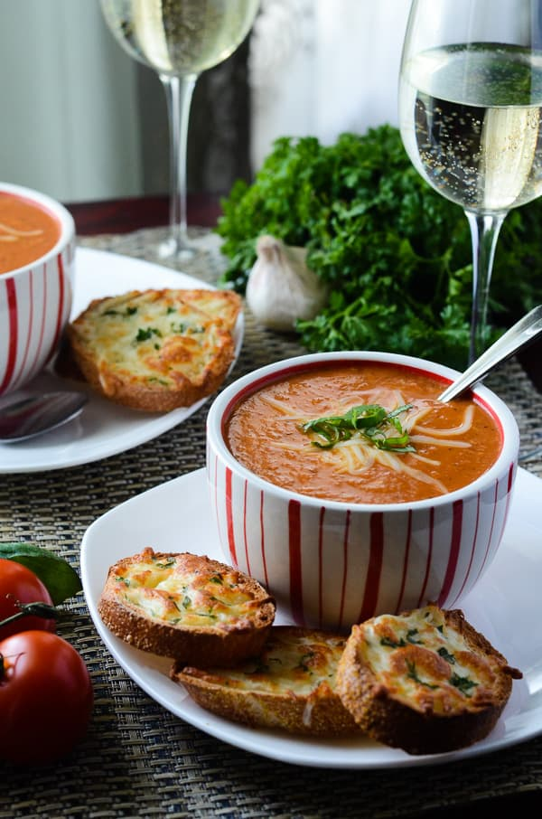 Crock Pot Roasted Tomato Bacon Bisque | An easy crock pot version of the ultimate comfort food - with a cheesy, bacony twist!
