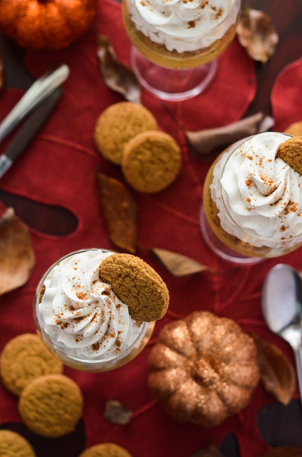 Pumpkin Pie Pots de Creme | Fall's favorite flavor, mixed up in a classic French dessert, and topped with crushed gingersnaps and a Maple Cinnamon Whipped Cream!