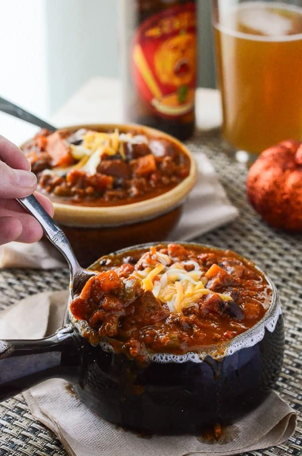 Spicy Pumpkin Sweet Potato Chili | This is not your ordinary crock pot chili - it's packed with pumpkin, sweet potato, beef, pork, beans, and tons of fall flavor!