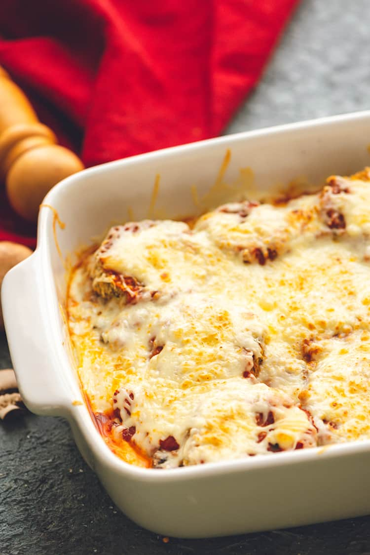 Baked Eggplant Parmesan out in a white casserole dish