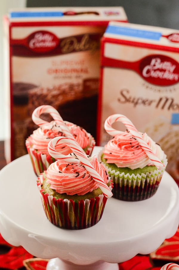 Mint Brownie Cupcakes | Two worlds collide in this quick and simple double-decker cupcake recipe - a layer of cake and brownie is topped off with a festive vanilla bean buttercream.