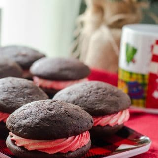 Peppermint Swirl Whoopie Pies | A cool & refreshing winter spin on a traditional Amish cookie, these puffy, cake-like treats are the perfect blend of chocolate and peppermint.