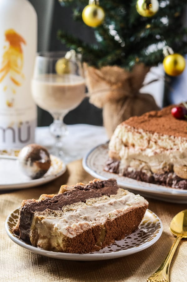 Tipsy Tiramisu Terrine | A cocktail-enhanced twist on classic tiramisu - coffee, dark chocolate, and white chocolate mousses, layered with espresso and mü-soaked ladyfingers. It's the ultimate grown-up dessert!