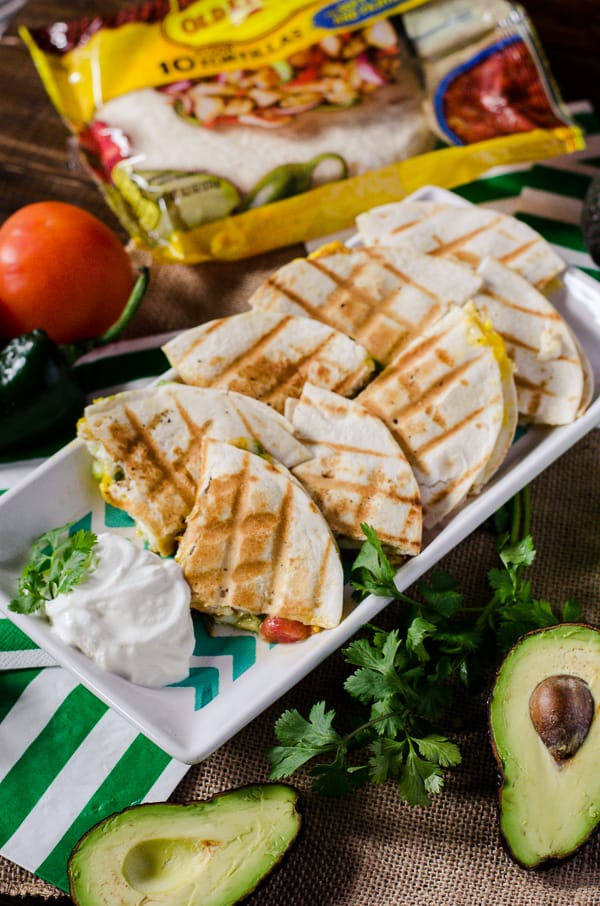 Huevos Rancheros Quesadillas | Go team avocado! This party-style take on a popular Mexican breakfast dish is loaded with green goodness, and begging to be served up for The Big Game.