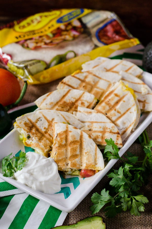 Huevos Rancheros Quesadillas   Go team avocado! This party-style take on a popular Mexican breakfast dish is loaded with green goodness, and begging to be served up for The Big Game.