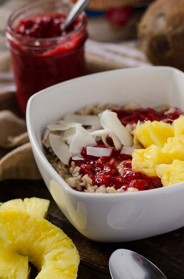 Pineapple Coconut Oatmeal with Strawberry Chia Jam | Creamy oatmeal, cooked in coconut milk and maple syrup, and swirled with homemade strawberry chia jam, fresh pineapple, and even more coconut - so good, it could be dessert!