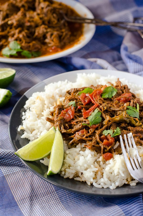 Ropa Vieja | Spanish for 'old clothes' thanks to its shredded appearance, this flavorful Cuban dish is made with lean beef and makes for a healthy Sunday Supper.
