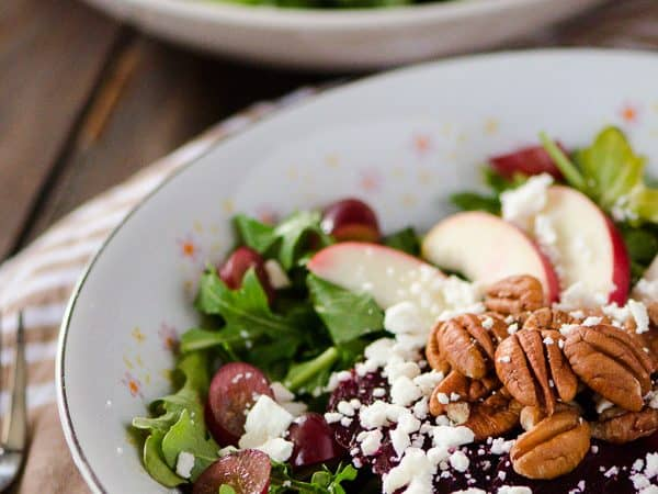 Crunchy Beet and Arugula Salad | These ain't your granny's beets! Fresh arugula, tossed with crisp apples, sweet grapes, crunchy toasted pecans, pickled beets, tangy feta, and drizzled with an avocado-lime vinaigrette.
