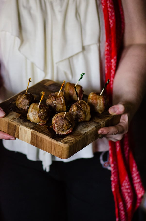 Bacon-Wrapped Cheese Stuffed Meatballs on a cutting board