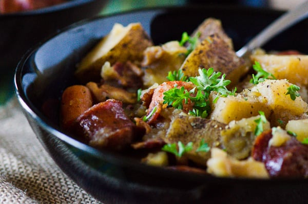 Dublin Coddle | Irish comfort food at its best! Bacon, sausage, caramelized onions, and potatoes cooked up in an apple cider-based stew - this is a delicious twist on a classic Irish stew.