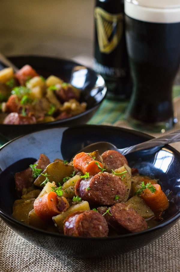Dublin Coddle   Irish comfort food at its best! Bacon, sausage, caramelized onions, and potatoes cooked up in an apple cider-based stew - this is a delicious twist on a classic Irish stew.