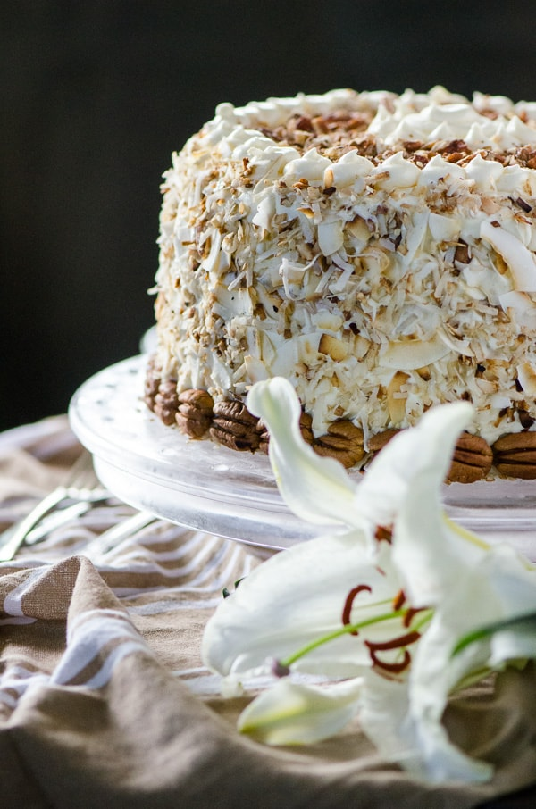 Italian Cream Cheesecake for your White Christmas. Two layers of classic Italian Cream Cake and a complementary layer of coconut pecan cheesecake sandwiched in the middle make for one amazing dessert! Così bello!