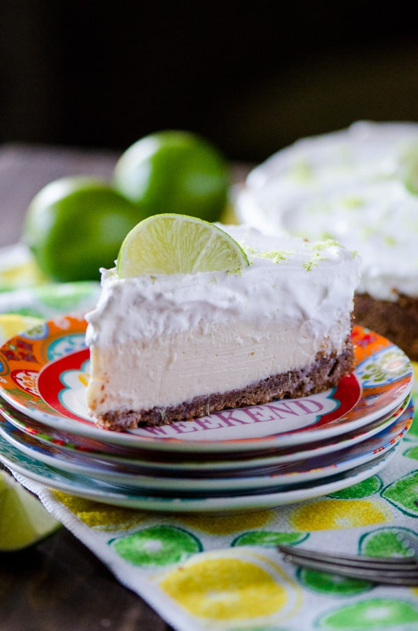 Key Lime Cream Pie | Sweet and tangy key lime filling, nestled in an almond graham cracker crust and topped with a generous helping of fresh whipped cream - the perfect Florida pie!