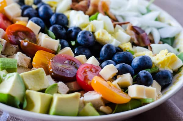 Blueberry Cobb Salad | An updated version of the classic Cobb Salad featuring antioxidant-rich blueberries, both whole and made into a delicious Blueberry Balsamic Vinaigrette!