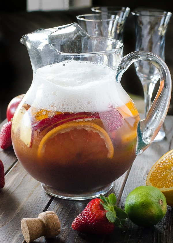 Brunch Sangria Mimosas | Can't decide between sangria or mimosa for brunch? Have both! Fresh fruit bathed in pineapple juice, champagne, and a little Creme de Cassis makes for a perfect weekend pick-me-up!