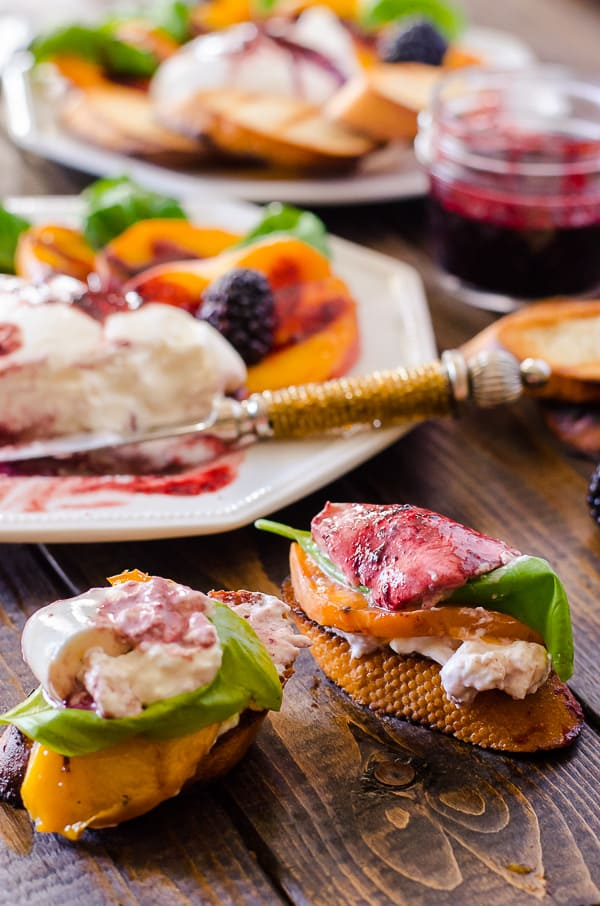 Transform a favorite Italian salad - Grilled Peach Caprese combines fresh peaches, burrata, basil, and blackberry balsamic into a perfect summer day appetizer!