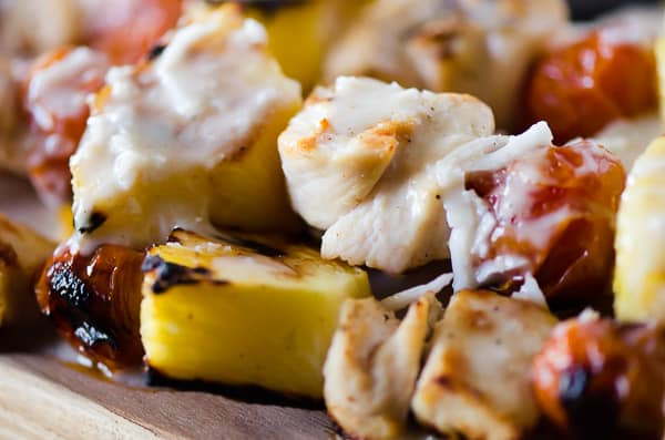 Fresh pineapple, cherry tomatoes, and coconut-marinated chicken take a classic cocktail to the grill and put it on dinner table with these Pina Colada Chicken Skewers!