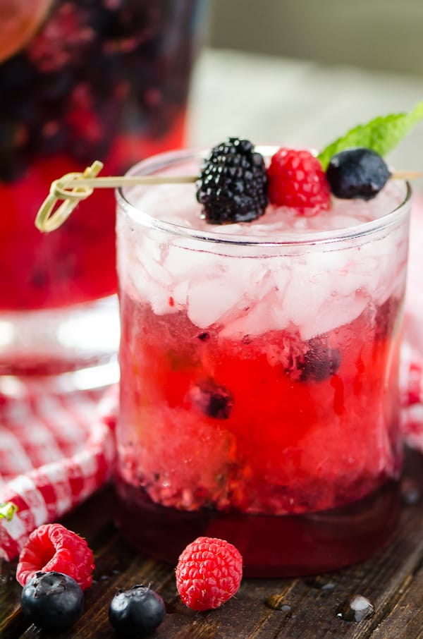 Traditional mojitos all jazzed up with fresh berries and raspberry seltzer, these quick and easy Summer Berry Pitcher Mojitos are sure to cool down a hot afternoon!