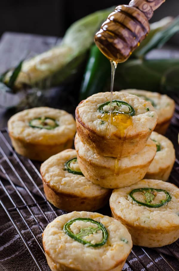 Kick up your cornbread game! These spicy, cheesy Jalapeno Popper Cornbread Muffins are the perfect side for fried chicken, chili, or just by themselves with a drizzle of honey!