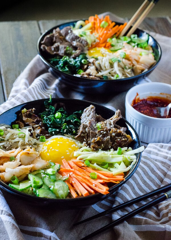 Step away from the buffet and try something different! Korean Bibimbap is an Asian food lover's dream - a bowl full crispy rice, lots of sautéed veggies, a fried egg, and some thinly sliced beef, all drizzled with a spicy sauce.