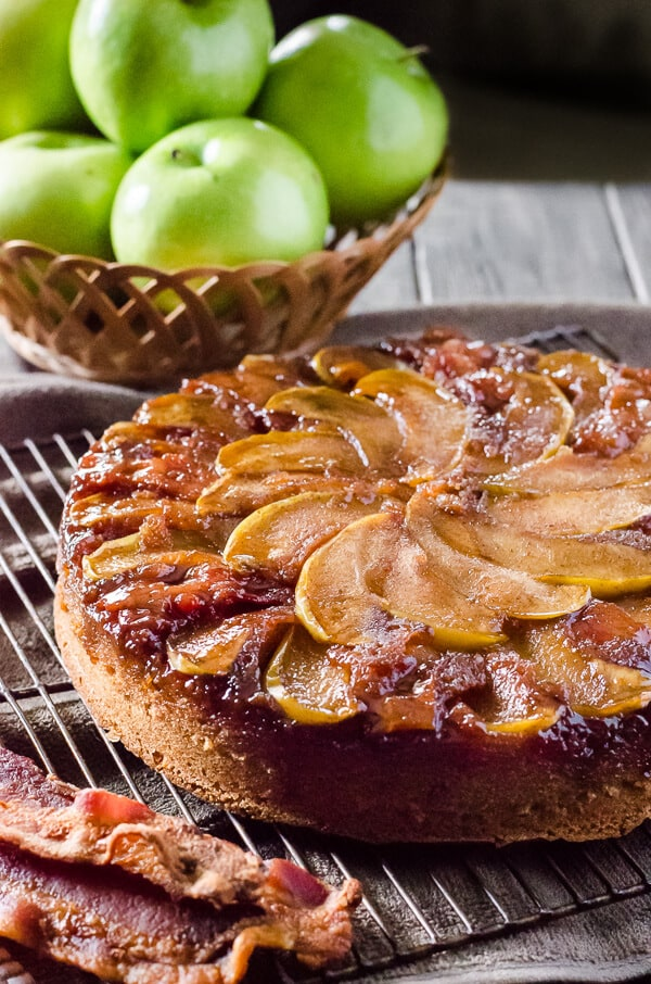 Fall flavors take center stage in this Spiced Apple Bacon Upside Down Cake! Maple-kissed apples and thick-sliced bacon top a simple bacon-infused spice cake - it's a treat perfect for any time of day!