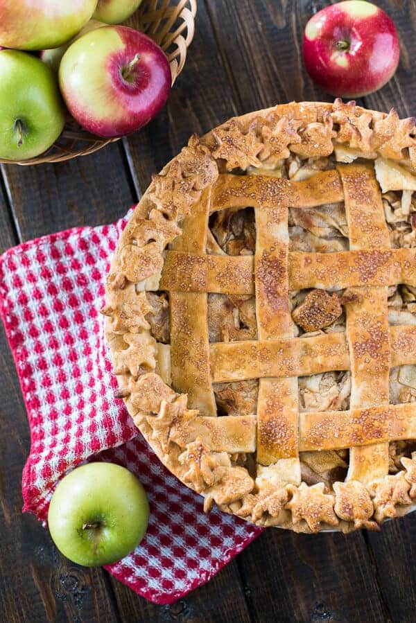 My Nana's Apple Pie is the perfect nostalgic fall dessert! Pounds of thinly sliced and spiced apples wrapped in a tender, flaky crust, decorated for the season - this baby is just begging for a big scoop of ice cream!