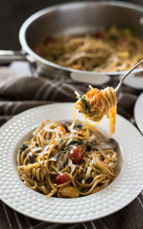 Looking for a delicious quick & easy weeknight meal? It doesn't get much better than One Pot Tomato Basil Pasta - linguine, fresh veggies, and a light, creamy sauce make this a dinner worth repeating!